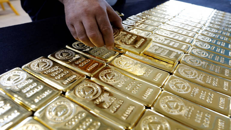 Gold price reversed early dip and climbed slightly