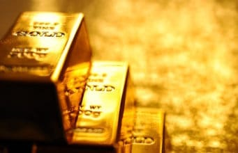 Gold prices trade