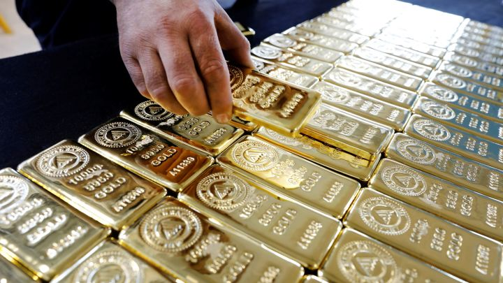 Gold price edged lower amid technical selling at 1,300 USD area