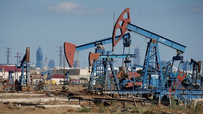 Crude oil prices edged lower on Friday amid hesitant trading
