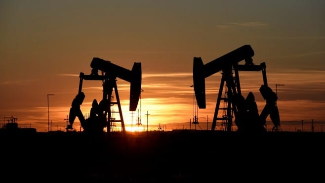 Crude oil prices edged lower under the pressure of the surprise US stockpile growth